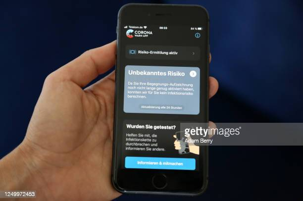 The German federal health ministry's CoronaWarnApp software is seen on an Apple iPhone in this photo illustration on the day of the app's release...