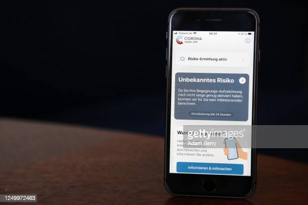The German federal health ministry's Corona-Warn-App software is seen on an Apple iPhone in this photo illustration on the day of the app's release...