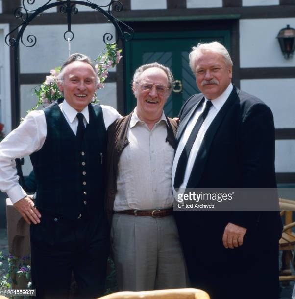 The German film and theater actor and voice actor Günter Strack poses for some pictures in front of the inn to the series 'These Drombuschs' with...