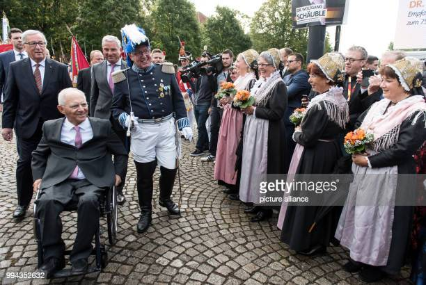 The German finance minister Wolfgang Schaeuble is greeted on his 75th birthday outside the Culture Centre in Offenburg Germany 18 September 2017...