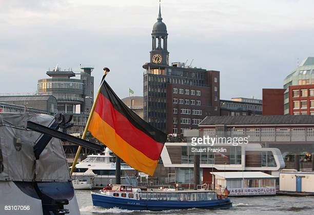 The German flag flys in the harbour in front of the Michel church during the German Unity day celebrations in October 3 2008 in Hamburg Germany