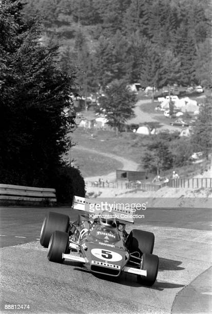The German Grand Prix; Nürburgring, August 1, 1971. The silver helmet identifies Mario Andretti as he drives his Ferrari 312B/F1 into the Karussel....