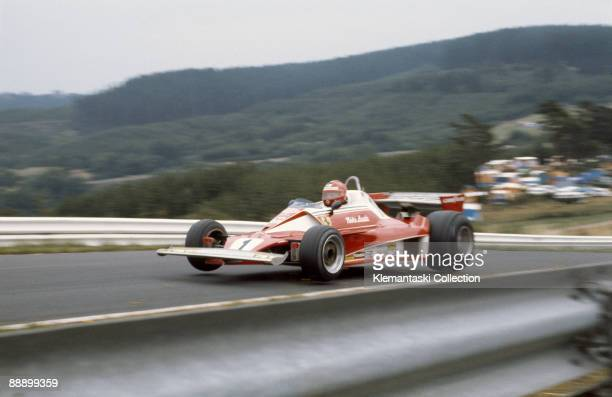 The German Grand Prix Nürburgring August 1 1976 Niki Lauda flying with is Ferrari 312T at Flugplatz during practice In the race he had a suspension...