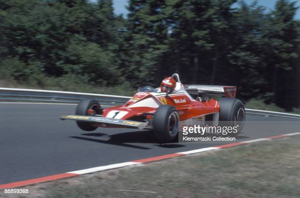 The German Grand Prix Nürburgring August 1 1976 Nikki Lauda flying with is Ferrari 312T at Flugplatz during practice In the race he had a suspension...
