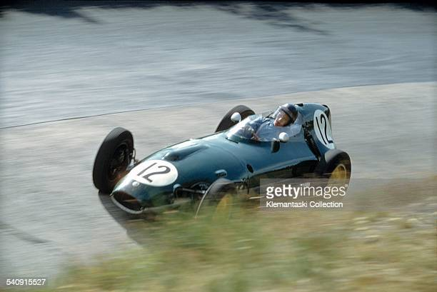 """The German Grand Prix Nürburgring August 3 1958 Cliff Allison with the Lotus 16 in the """"ditch"""" of the Karussel during practice"""