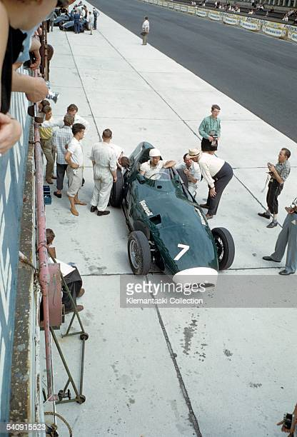 The German Grand Prix, Nürburgring, August 3, 1958. During practice Stirling Moss informs team owner Tony Vandervell how the Vanwall is performing.