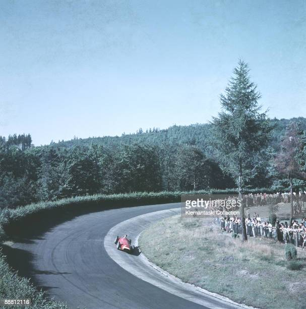 The German Grand Prix; Nürburgring, August 4, 1957. Juan Manuel Fangio in the 'ditch' of the famous Karussel in his Maserati 250F with part of the...