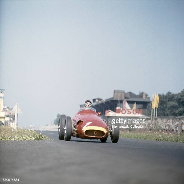 The German Grand Prix; Nürburgring, August 4, 1957. Juan Manuel Fangio braking into the South Curve during the early part of the race when he was far...
