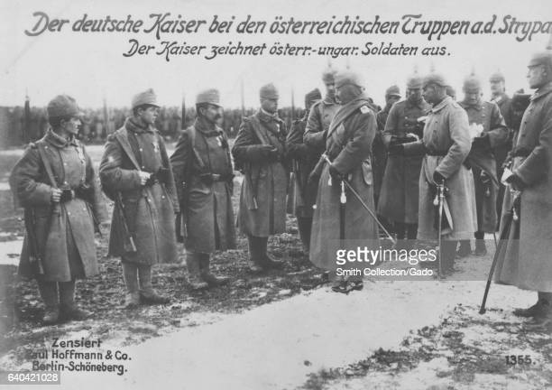 The German Kaiser Wilhelm II in front of a line of Austrian troops, World War I, 1914. From the New York Public Library. .