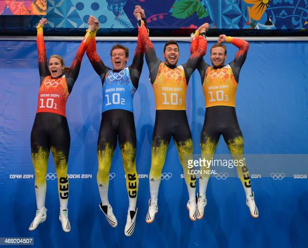 The German Luge Team of Natalie Geisenberger Felix Loch Tobias Wendl and Tobias Arlt celebrate at the Luge Team Relay Flower Ceremony at the Sliding...
