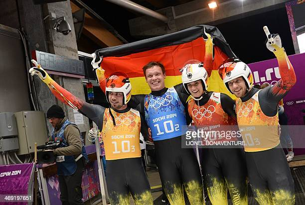 The German Luge Team of Tobias Wendl Felix Loch Natalie Geisenberger and Tobias Arlt celebrate their Gold Medal in Luge Team Relay at the Sliding...