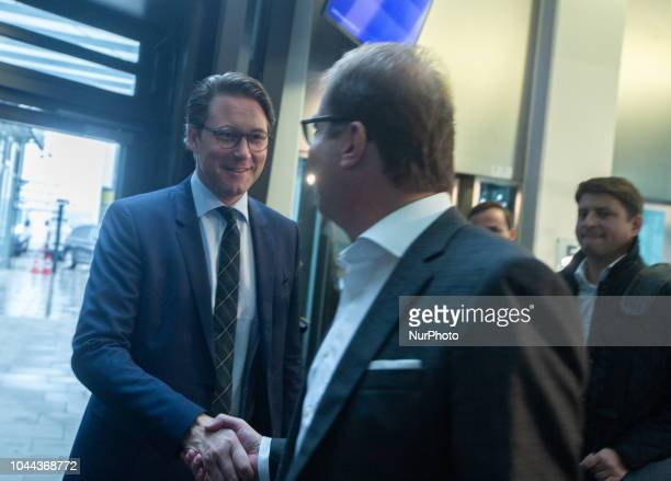 The German MInister of Transport Andreas Scheuer and the head of the CSU regional group in the Bundestag Alexander Dobrindt shaking hands in Munich...