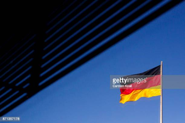 The German National Flag waves on the top during the second phase of coalition negotiations at the Reichstag on November 7 2017 in Berlin Germany For...