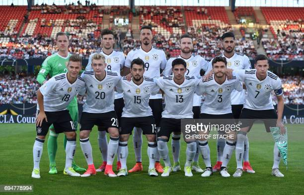 The German national football team first row left to right defender Joshua Kimmich midfielder Julian Brandt midfielder Amin Younes midfielder Lars...