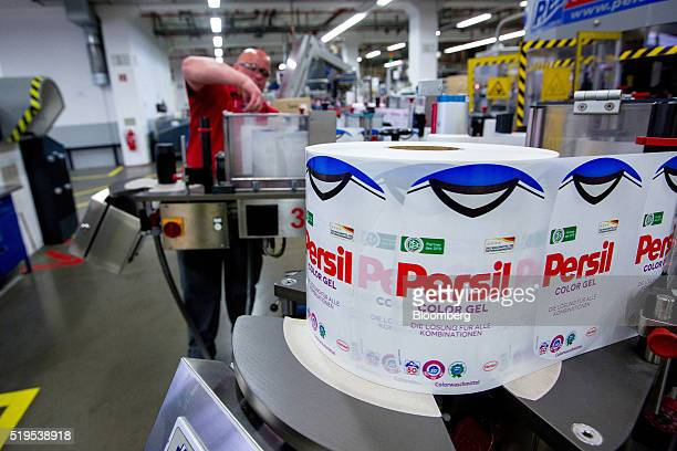 The German national soccer team shirt sits on a spool of labels for Persil color gel laundry detergent inside the Henkel AG factory in Duesseldorf...