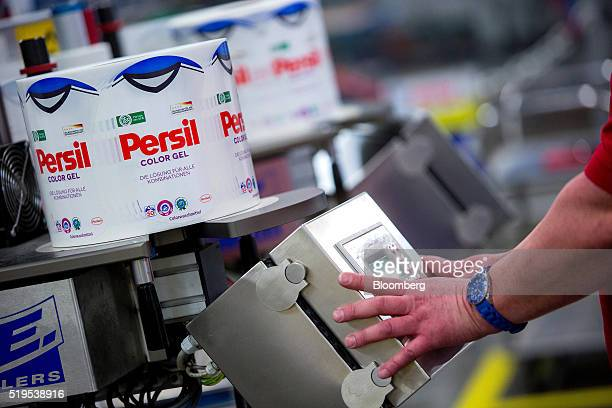 The German national soccer team shirt sits on spools of labels for Persil color gel laundry detergent inside the Henkel AG factory in Duesseldorf...