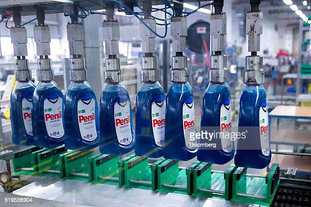 The German national soccer team shirt used as a background for the labels on bottles of Persil color gel laundry detergent are seen inside the Henkel...