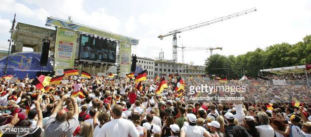 The German National Team arrive at the Berlin Fan Mile at the Brandenburg Gate on July 9 2006 in Berlin Germany Hundreds of thousends of fans...
