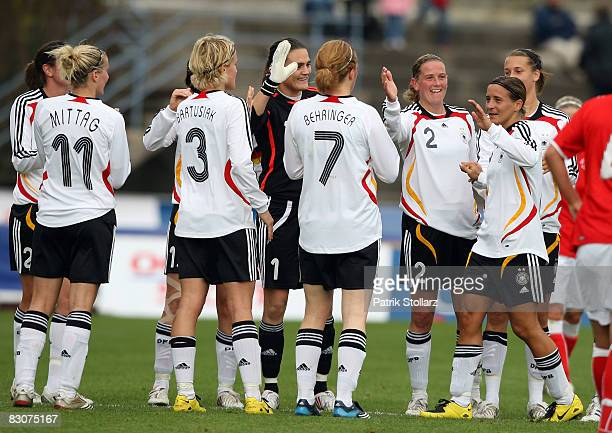 The German national team celebrate Sandra Smisek of Germany after her last match for the national team during the 2009 UEFA European Championship...