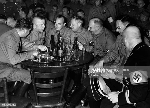 The German Nazi politician Dr Hans Frank with Governor Ammann Corps leader Huehnlein and Reichs Minister D Lammers in the historic beer cellar in...