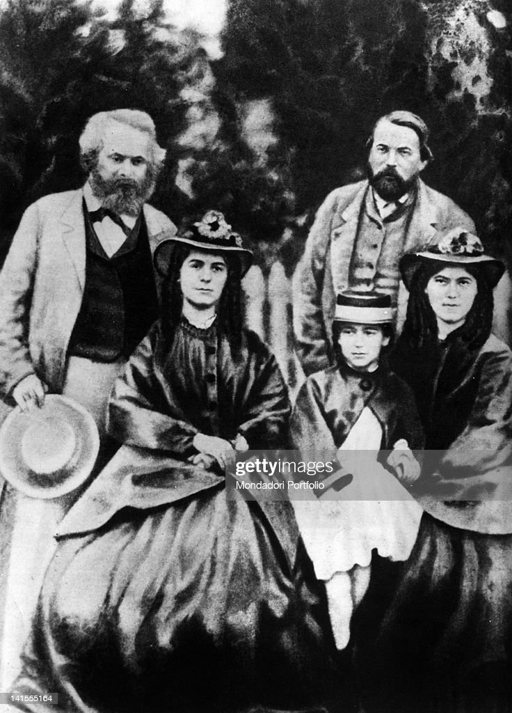 The German philosopher Karl Marx posing with the economist Friedrich Engels, his wife Jenny and his daughters Laura and Eleanor. 1870s