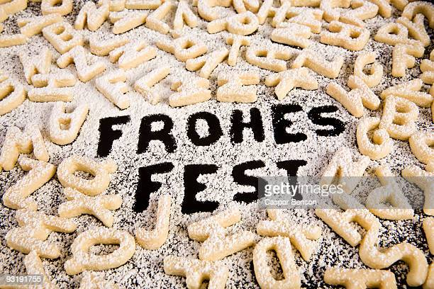 The German phrase Frohes Fest spelled out in powdered sugar