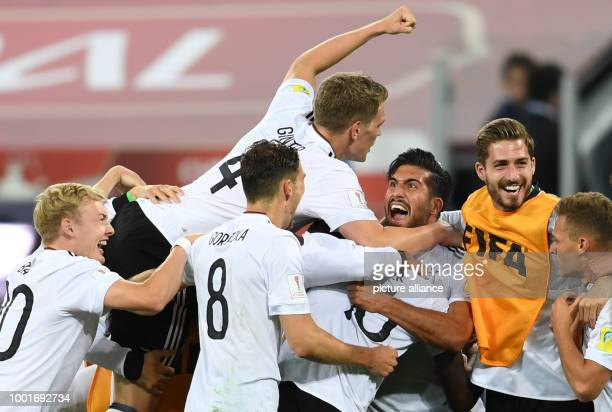 The German players Julian Brandt Leon Goretzka Matthias Ginter Emre Can Kevin Trapp and Joshua Kimmich cheer after the Confederations Cup finale...
