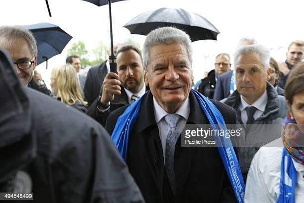 REGENSBURG BAVARIA GERMANY The German President Joachim Gauck walks across the The Katholikentagsmeile is an area at the Deutscher Katholikentag...