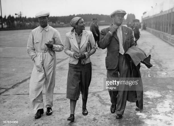 The German racing driver Bernd Rosemeyer with his wife Elly Beinhorn and Manfred von Brauchitsch on the Nürburgring. July 26th 1936. Photograph. Der...
