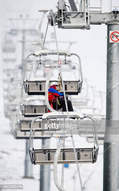 The German Red Cross mountain rescue practices on the ski lift at the new ski piste 'Sonnenhang' on the Wurmberg in the Harz Mountains in Braunlage...