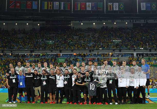 The German side line up following the Men's Football Final between Brazil and Germany at the Maracana Stadium on Day 15 of the Rio 2016 Olympic Games...