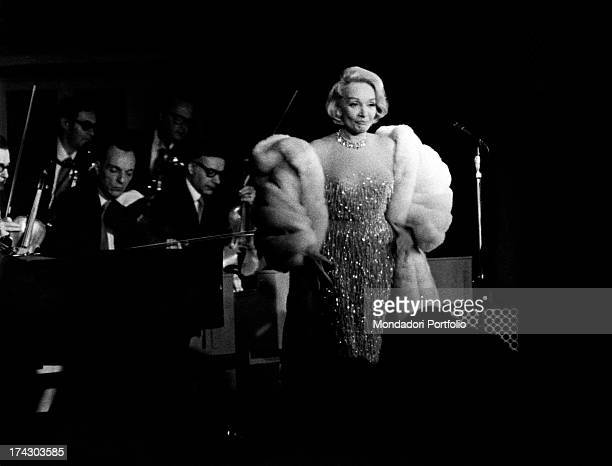 The German singer and actress Marlene Dietrich during her musical show at the Bussola a fashion Versilia night club Viareggio 1972