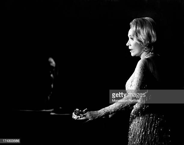 The German singer and actress Marlene Dietrich performs at the Bussola a fashion Versilia night club Viareggio 1972
