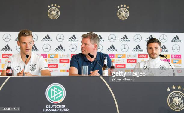 The German soccer player Joshua Kimmich , the speaker of the team Jens Grittner and the player Jonas Hector during a press conference held before the...
