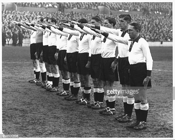 The German soccer team give a Nazi salute at the start of a match against England in 1936