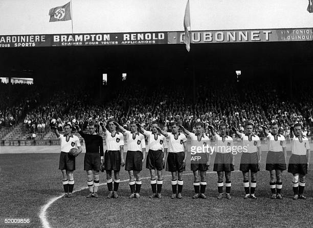 The German soccer team gives the Nazi salute before the Germany against Switzerland match of the Soccer World Cup 05 June 1938 in Paris France