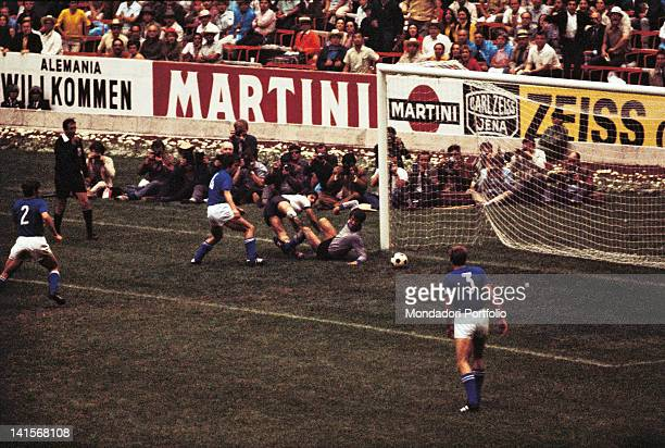 The German striker Gerd Muller is about to score the first goal in the semi final of the World Cup Championship played between Italy and West Germany...