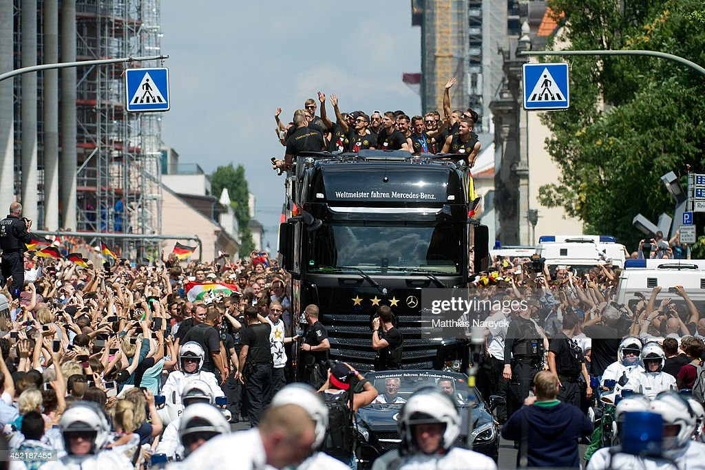 The German team arrives at Brandenburg Gate to celebrate on stage at the German team victory ceremony on July 15, 2014 in Berlin, Germany. Germany won the 2014 FIFA World Cup Brazil match against Argentina in Rio de Janeiro on July 13.