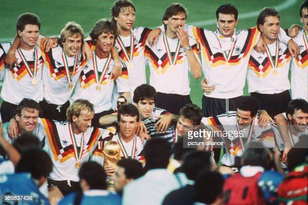 The German team assembles for a team photo after the presentation ceremony of the 1990 World Cup Stefan Reuter Juergen Klinsmann Frank Mill Guido...