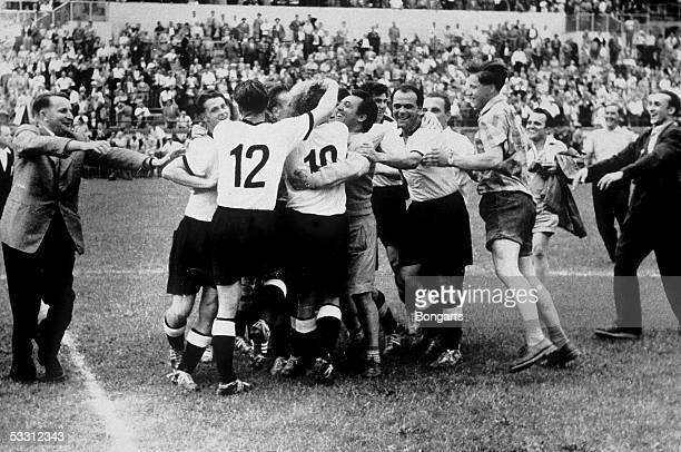 The German Team celebrate after they won the FIFA World Cup 1954 final match between Hungary and Germany on July 4 1954 in Bern Switzerland