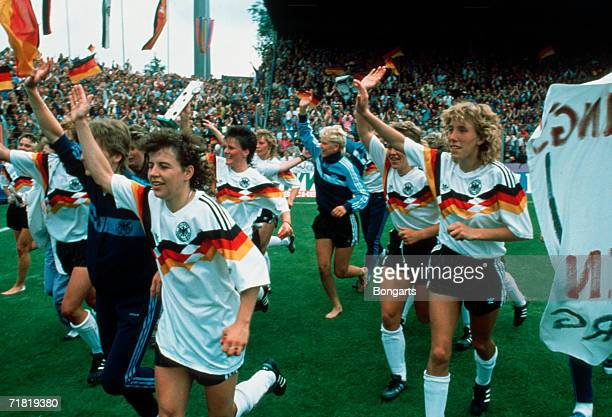 The German team celebrate after winning the women's European Championship final match between Norway and Germany at the Stadium Bremer Bruecke on...