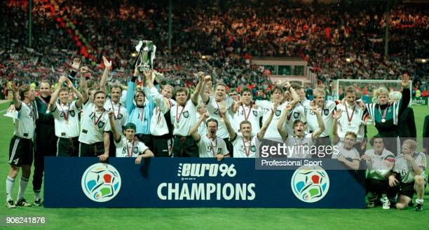 The German team celebrate their victory with the trophy following their victory over the Czech Republic in the UEFA Euro96 final at Wembley Stadium...