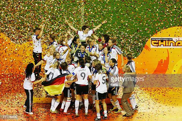 The German team celebrate victory on the podium after winning the Women's World Cup 2007 Final match between Brazil and Germany at the Shanghai...