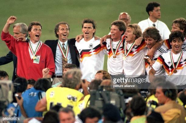 After the 1990 FIFA World Cup final Argentina Germany 01 the German team is celebrating Holger Osieck Franz Beckenbauer Klaus Augenthaler Stefan...
