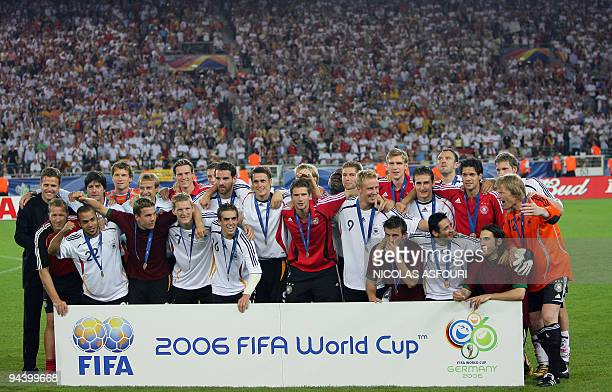 The German team pose together after the medal presentation ceremony at the end of the thirdplace playoff 2006 World Cup football match between...