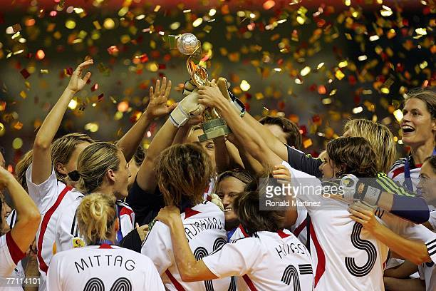 The German team raises the FIFA Women's World Cup 2007 trophy after defeating Brazil 20 at Shanghai Hongkou Football Stadium on September 30 2007 in...