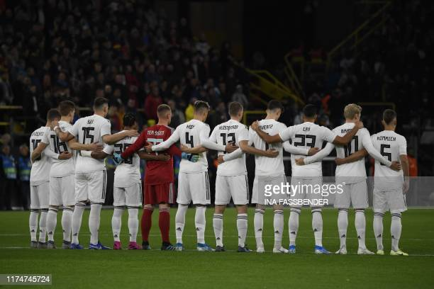 The German team stands for a minute of silence for the victims of a shooting at a synagogue in Halle prior to a friendly soccer match between Germany...