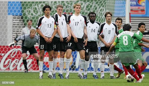 The German Team with Michael Ballack Robert Huth Per Mertesacker Gerald Asamoah and Torsten Frings expecting the free kick of Pavel Pardo of Mexico...