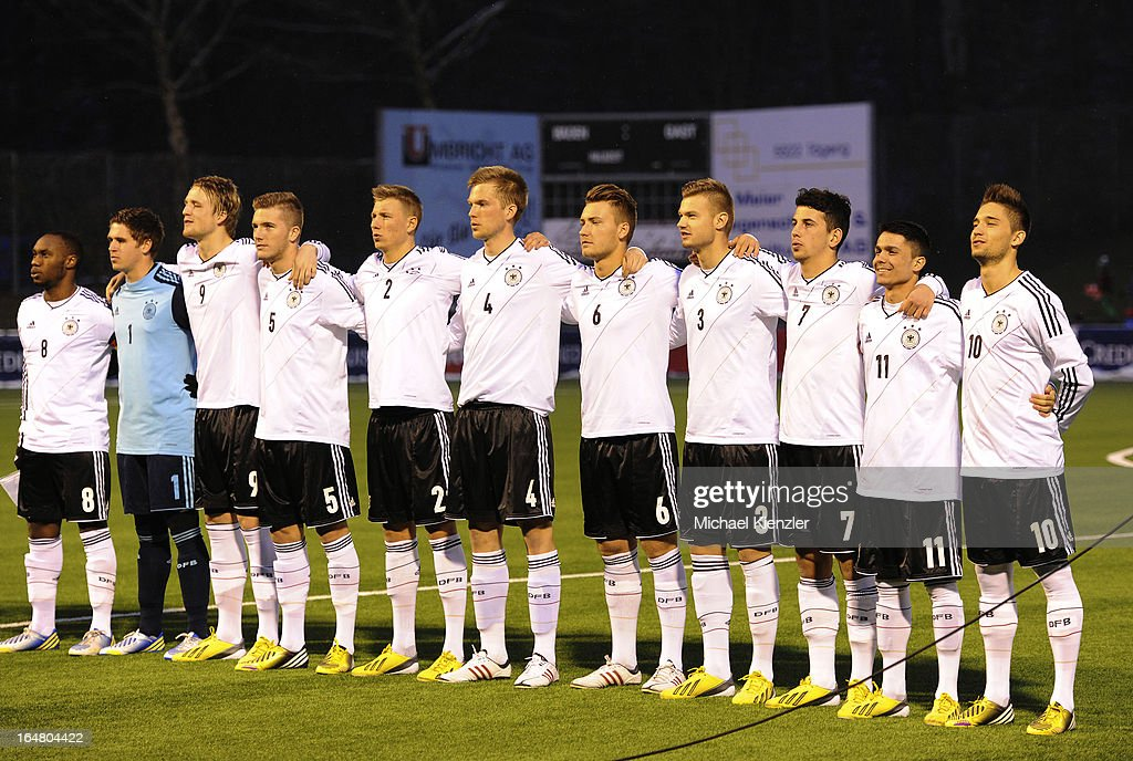 The German team with Reinhold Yabo, Patrick Rakovsky, Philipp Hofmann, Andre Hoffmann, Tobias Schilk, Pelle Jensen, Tom Trybull, Florian Hartherz, Julian Derstroff, Leonardo Bittencourt and Moritz Leitner (L-R) singing the national anthem before the international friendly match between U20 Switzerland and U20 Germany at Eps Stadium on March 26, 2013 in Baden, Switzerland