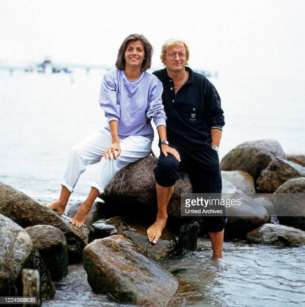 The German television presenter Birgit Schrowange poses on rocks with a man on vacation Germany circa 1989